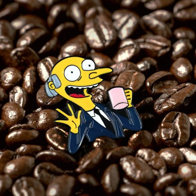 Simpsons Mr. Burns Coffee Time Pin among coffee beans
